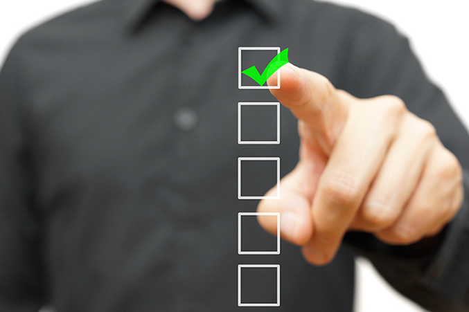 Photo of a finger pointing at a checkbox from a Hapman blog