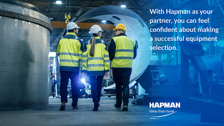 Image of people walking in hard hats on a factory floor from Hapman blog