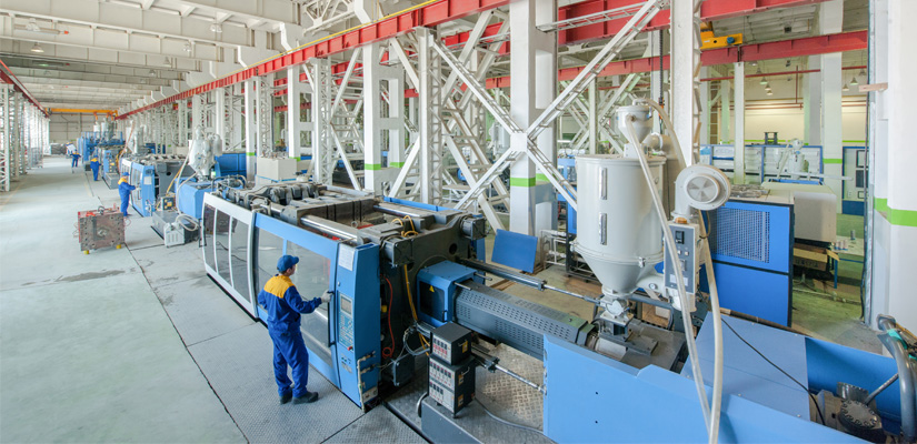 Wide view of Hapman bulk bag filler system on a factory floor