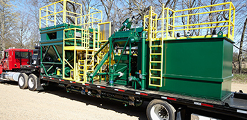 Side view of a mobile industrial processing system designed by Hapman
