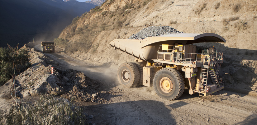 Photo of mining vehicles conveying materials from Hapman Application Review