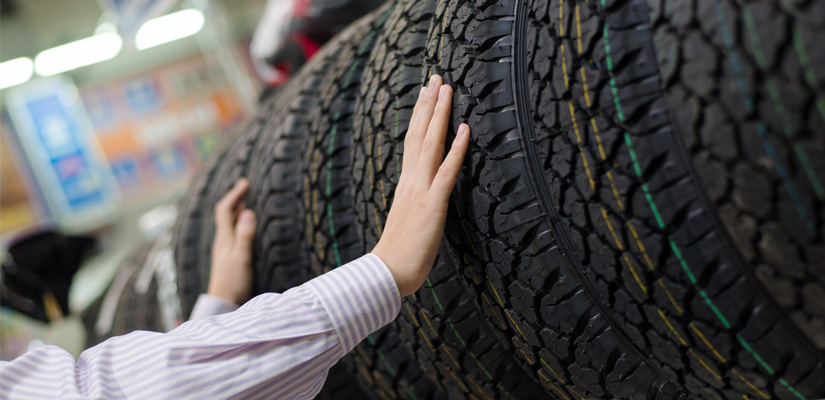 Image of hands touching tire treads from Hapman Application Review