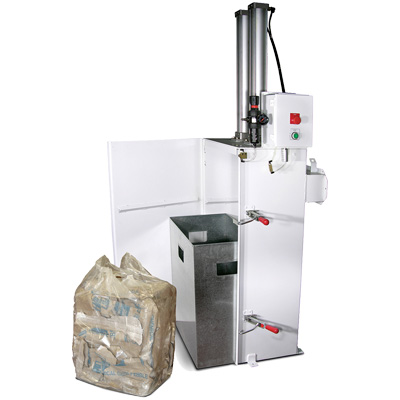 Side view of a Hapman bag compactor with bag of compacted material