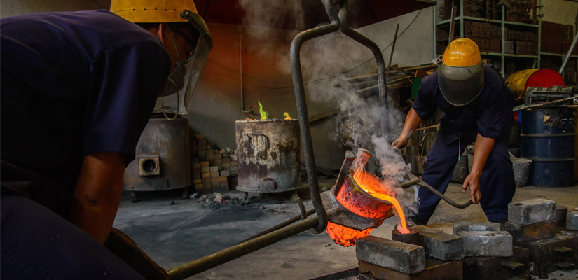 Images of workers pouring molten metal into molds