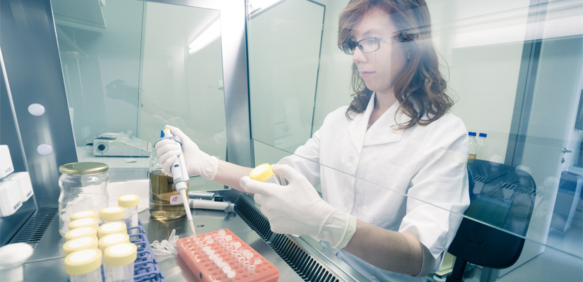 Image of woman working in lab at the Uniformed Services University of the Health Sciences