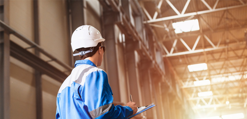 Image of worker in hard had surveying plant floor